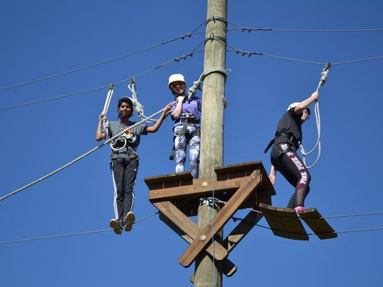 Students Viren Talati, Caroline Lock and Svetlana Stephen on the challenge course.