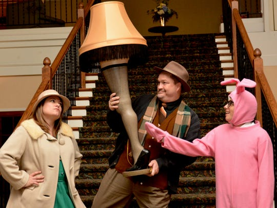 "Ralphie's mother (Adrian Cargal); his Old Man (Dr. Jonathan Williams) and Ralphie (Mastalsz) with the infamous leg lamp in ""Christmas Story: The Musical"" which opens at 7:30 p.m. tonight at the Wichita Theater and also plays at 3 p.m. Saturday."