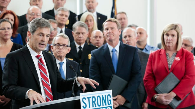 Ohio Sen. Matt Dolan speaks during a news conference at the Ohio Department of Public Safety in Columbus in 2019. Dolan says an aid package for small businesses and people struggling to pay rent during the coronavirus pandemic is coming soon.