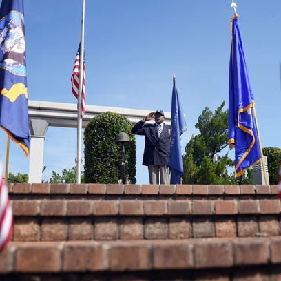 Charles Brown salutes as the Hattiesburg community
