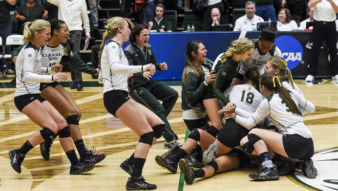 The CSU volleyball team celebrates a 3-2 win over CU to advance to the Sweet 16 in the 2014 NCAA tournament. The win is one of the most memorable from 22 consecutive NCAA tournament appearances for the Rams.