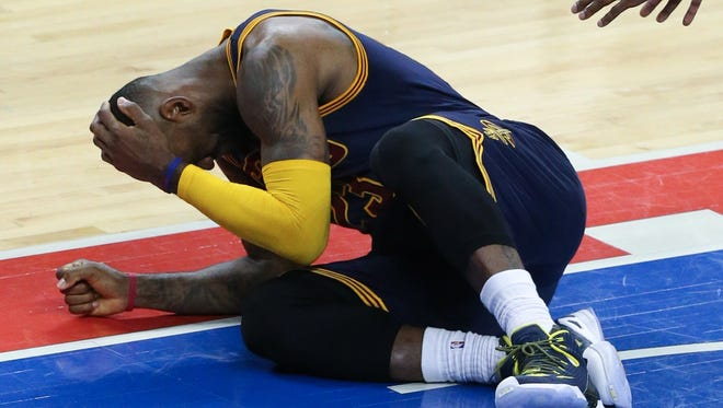 Cavaliers forward LeBron James after a foul during Game 3 at the Palace.