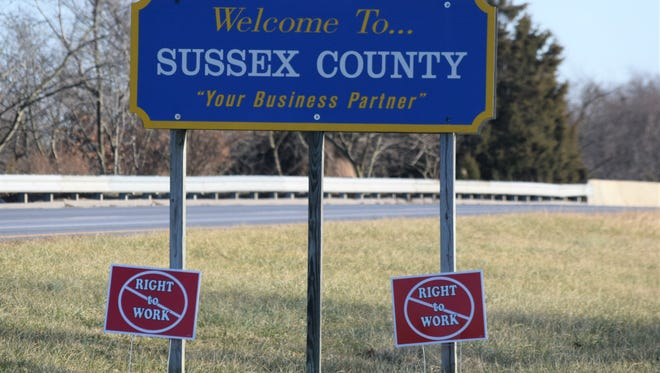 Anti-right-to-work signs are seen below a Welcome to Sussex County sign on Del. 1, just north of Milford.