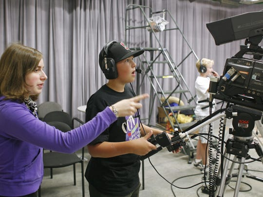 Abby Brokaw, a student trainer, gives instructions to Benjamin Kizer during a previous summer camp hosted by CCTV.