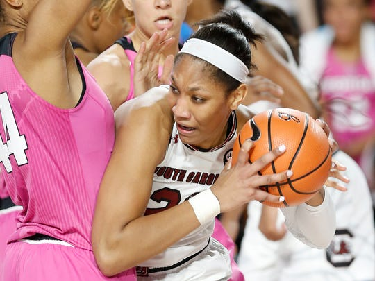 South Carolina forward A'ja Wilson (22) looks for an open pass while being defended by Georgia forward Malury Bates (44) during an NCAA college basketball game Thursday, Feb. 15, 2018, in Athens, Ga. (Joshua L. Jones/Athens Banner-Herald via AP)