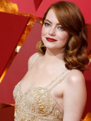 Emma Stone arrives for the 89th annual Academy Awards ceremony.