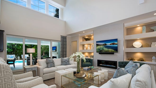 Stock Custom Homes' residence at 3750 Fountainhead Lane in Park Shore is available priced at $3.395 million with furnishings. The 4,189-square-foot two-story residence showcases an interior by Clive Daniel Home.