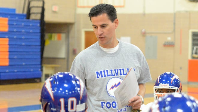 File photo: Jason Durham addresses his players during practice in the high school gym.