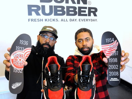Burn Rubber sneaker boutique co-owners Rick Williams, left, 36, of Southfield, and Roland Coit, 38, of Auburn Hills, show the Reebok Bolton at their Royal Oak store. They were commissioned by Reebok to design the shoe, which retails for $140 and pays tribute to the Detroit Red Wings.