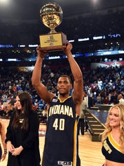 Indiana Pacers forward Glenn Robinson III (40) celebrates winning the slam dunk contest during NBA All-Star Saturday Night at Smoothie King Center.