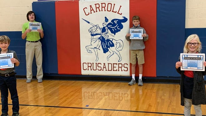 October students of the month at Carroll Catholic are from left: Kale Singleton, Wyatt Ulvestad, Tate Aue and Ashton Maxheimer.