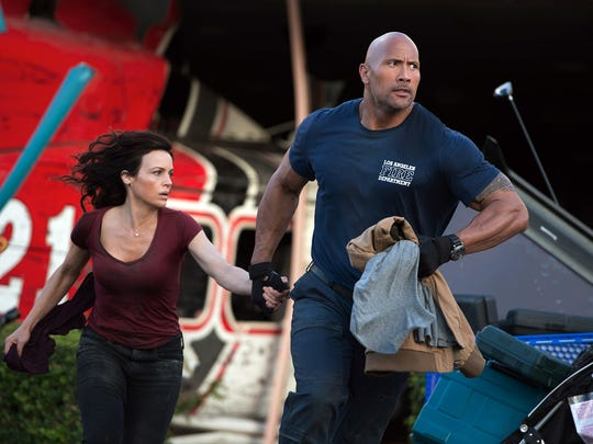 """Carla Gugino and Dwayne Johnson in a scene from the motion picture """"San Andreas."""""""