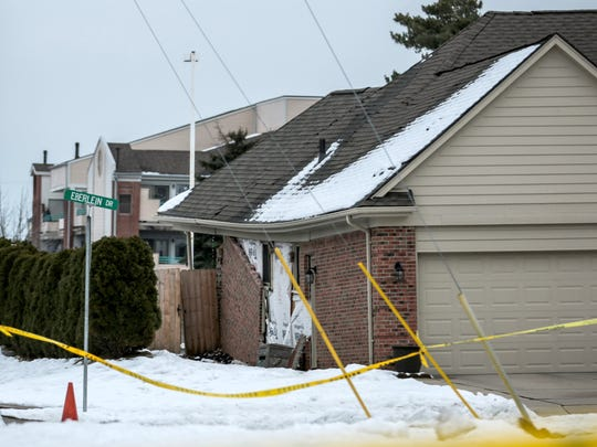 A sinkhole closes 15 Mile between Hayes and Utica because of a partially collapsing a home on Saturday, December 24, 2016 in Fraser.