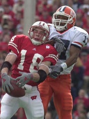 Jim Leonhard intercepts a pass intended for Illinois' Greg Lewis in 2002.