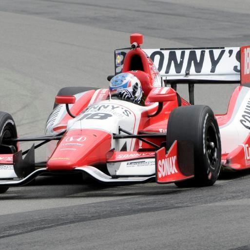 James Davison, of Austrailia, takes a corner during practice for the Honda Indy 200 at Mid-Ohio in Lexington, OH Friday, Aug. 2, 2013. (AP Photo/Tom E. Puskar)