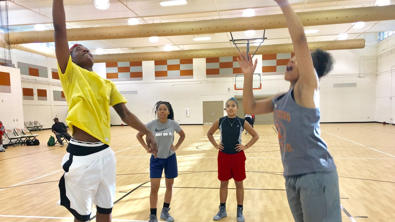 Dunbar High girls basketball coach Dwayne Donnell and senior forward Ja'miah Bland, the program's latest D-I recruit, discuss the program's success making sure players are pushed, supported and sometimes taught tough lessons to help them succeed.