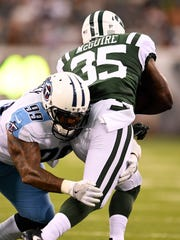 Titans defensive end Jurrell Casey (99) stops Jets