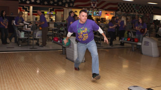 Joe Mathis of Fairway Mortgage, one of 11 banks that participated in Bowl for Kids' Sake, takes a shot during the 32nd annual fundraiser for BBBS of Clarksville, a mentoring program that helps approximately 200 kids at any given time.