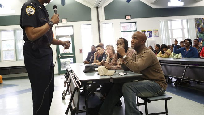 Gainesville Police Chief Tony Jones answers questions from citizens about issues in the Duval neighborhood during a community meeting in 2019.