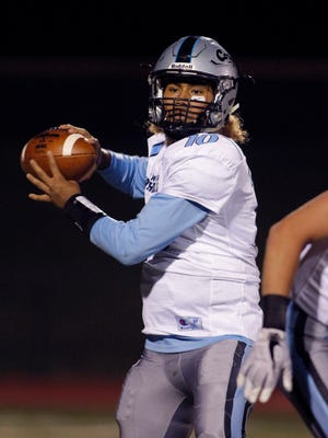 Lansing Catholic quarterback Michael Lynn III throws a pass against Olivet Friday, Oct. 27, 2017, in Olivet, Mich. Lansing Catholic won 42-20.