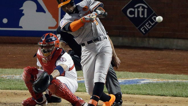 The American League's Adam Jones of the Baltimore Orioles hits a double during the 2013 MLB All-Star Game at Citi Field in New York.
