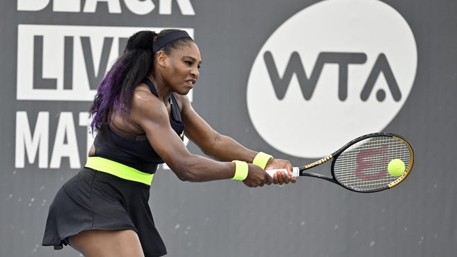 Serena Williams returns a shot to her sister Venus Williams during the WTP tournament in Nicholasville, Ky., on Thursday.