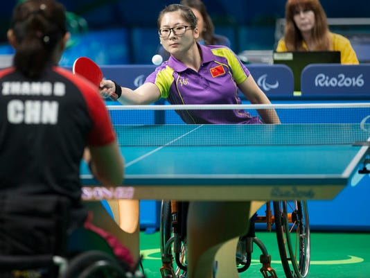 In this Monday, Sept. 12, 2016, photo, Gu Gaii, of China, returns a shot against teammate Zhang Bian in the gold-medal match in table tennis at the Paralympic Games in Rio de Janeiro. Zhang won 11-6, 11-6, 11-6. Their match was one of two to decide a gold medal on Monday that featured athletes from China only. (Antonella Crescimbeni/Penn State University via AP)