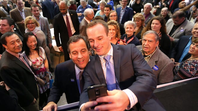 New Jersey Gov. Chris Christie poses for a selfie with Bryan Traeger of West Des Moines during Gov. Terry Branstad's birthday bash on Saturday in Clive.