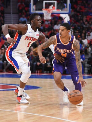 Suns guard Tyler Ulis (8) drives to the basket as Pistons guard Reggie Jackson (1) defends during the first quarter on Wednesday, Nov. 29, 2017, at Little Caesars Arena.