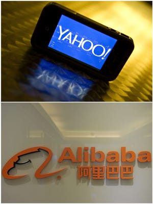 A file combo picture shows the Yahoo logo  on a smartphone and the Alibaba.com logo.