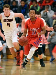 Apollo's Robson Omar breaks away with the ball past