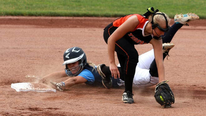 Timber Stoops slides safely into second base during the Division IV state semifinal game against Strasburg. The Falcons could not hold off the Tigers, though, and lost 2-0.