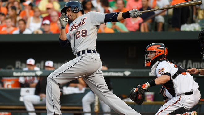 Tigers rightfielder J.D. Martinez hits a two run double during the first inning tonight in Baltimore.