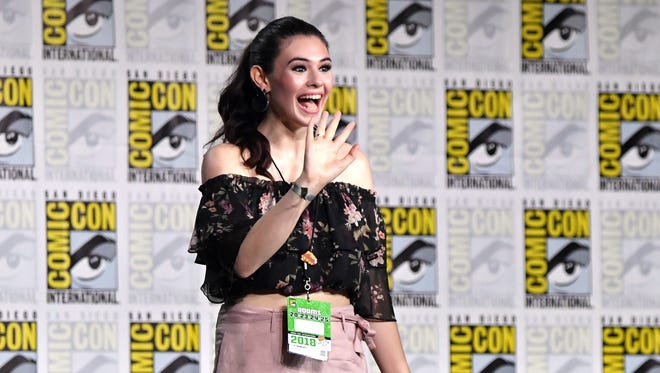 "Nicole Maines walks onstage at the ""Supergirl"" presentation at Comic-Con, where they announced she was cast as Dreamer."