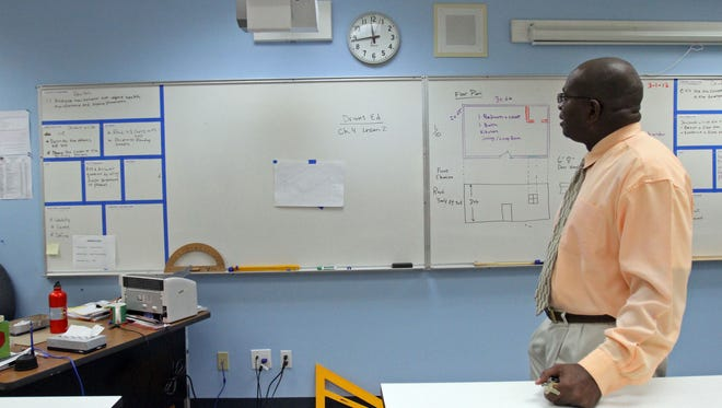 Rudy Wilson, principal of West Shores Middle and High Schools, shows some of the technology that was purchased for the school using school improvement grant funding including this interactive projector inside a mechanical drawing classroom on Thursday, March 1, 2012 in Salton City, Calif.