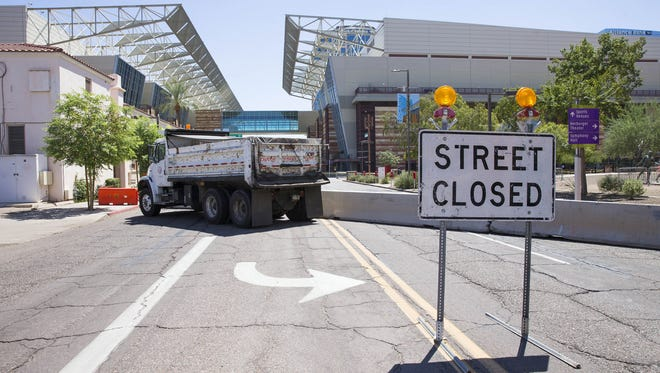 A dump truck and barricades block Third Street leading to the Phoenix Convention Center Aug. 22, 2017, where President Trump will hold a rally in the evening.