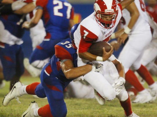 Indio High School's Aaron Ortiz tackles Desert Mirage High School's Anthony Marmolejo during their game at Ed White Stadium in Indio on August 25, 2017.