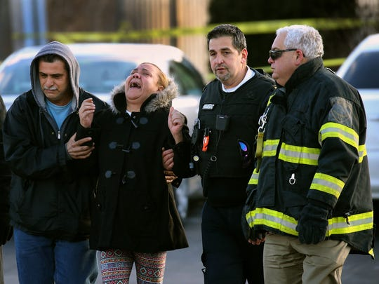Family members are comforted at the scene of a fatal shooting that occurred on East Ridge Road in Irondequoit.