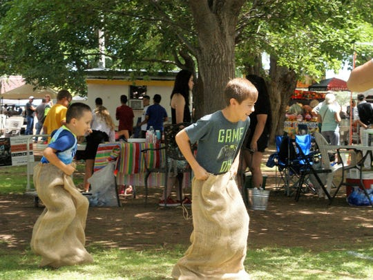 Sack races were a big hit at the Kids' Zone during the Salsa festival.