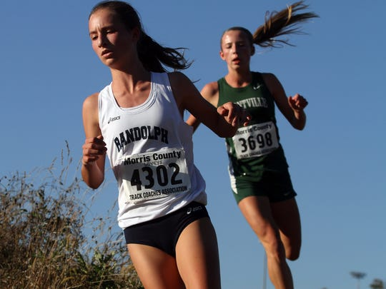 Randolph freshman Abby Loveys leads Montville freshman Anna George during the Northwest Jersey Athletic Conference varsity girls large school cross country championships at Greystone Park. October 20, 2015, Morris Plains, NJ