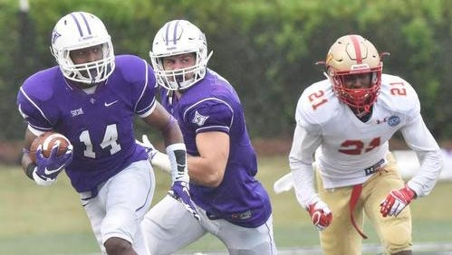 Furman's Reggie Thomas (14) returns an interception against VMI this season. The Abbeville native will make his 46th and final start when the Paladins wrap up the 2015 season at Wofford Saturday.