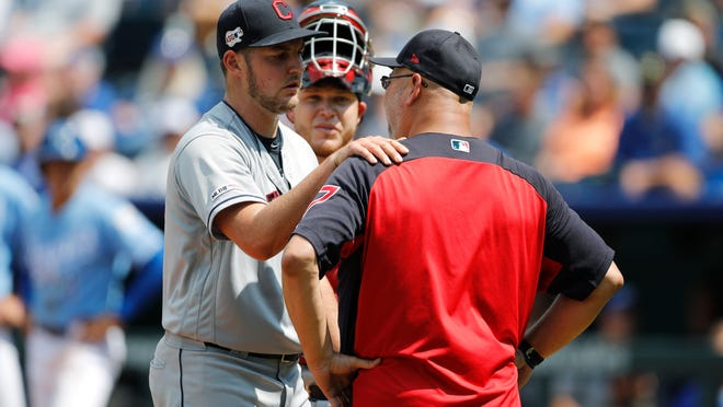 Cleveland Indians pitcher Trevor Bauer, left, reacts as he is taken out by manager Terry Francona in the fifth inning of a baseball game against the Kansas City Royals at Kauffman Stadium in Kansas City, Mo., Sunday, July 28, 2019. (AP Photo/Colin E. Braley)