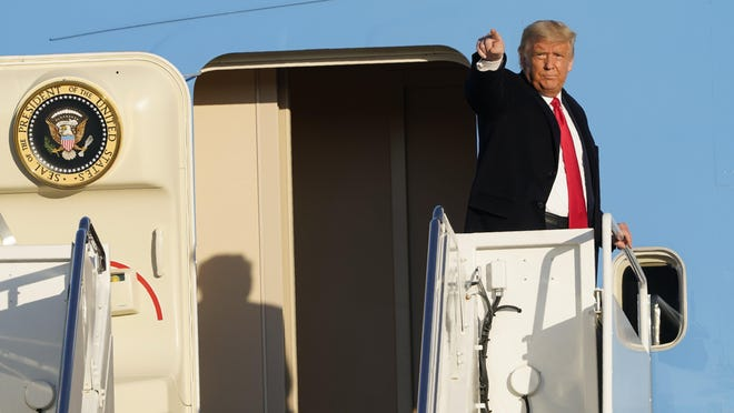 President Donald Trump gestures Oct. 21 from the top of the steps of Air Force One at Andrews Air Force Base. His administration last month proposed new limits on student visas.