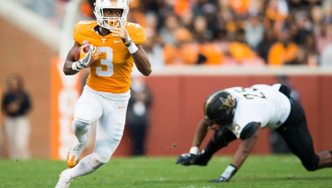 Tennessee running back Ty Chandler (3) looks out for Vanderbilt players while running the ball during a game between Tennessee and Vanderbilt at Neyland Stadium in Knoxville, Tenn., on Saturday Nov. 25, 2017.
