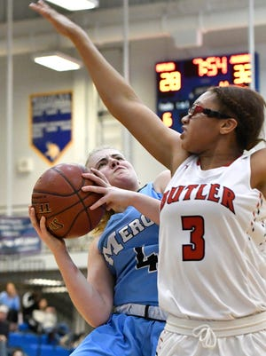 Mercy guard Hope Sivori (4) attempts a shot over the defense of Butler guard Dynastee White (3) during the second half of their game, Wednesday, Feb. 28, 2018 in Louisville.