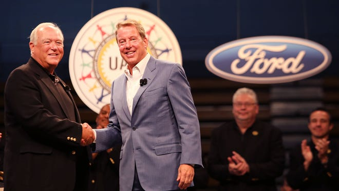 UAW President Dennis Williams, left, and Ford Executive Chairman Bill Ford Jr. at Cass Technical High School in Detroit on July 23, marking the official start of contract talks between Ford and the UAW.