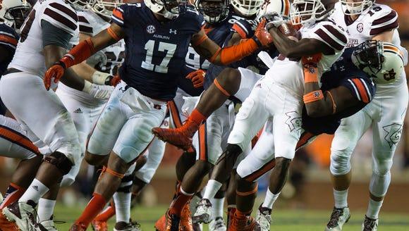 Auburn linebacker Jeff Holland (4) tackles Mississippi