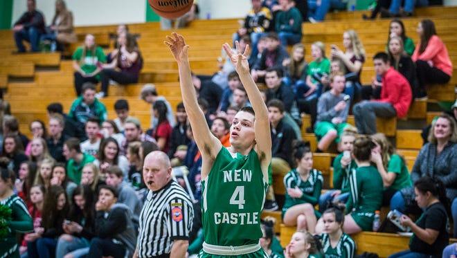 New Castle's Andrew Garrett shoots past Yorktown's defense during their game at Yorktown High School Friday, Jan. 22, 2016.