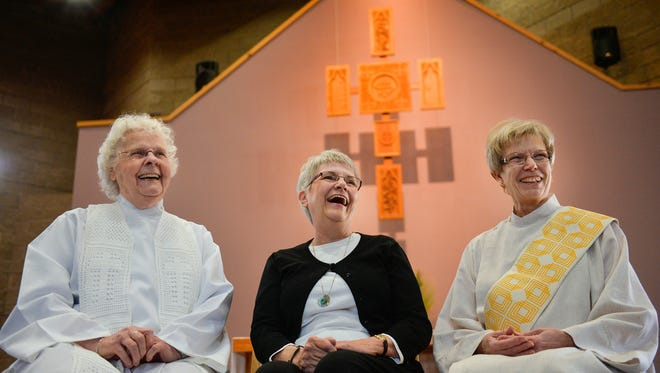 The Rev. Bernie Sykora, a womanpriest, from left, Rose Henzler, studying to become a womanpriest, and Ruth Lindstedt, who will be ordained April 10, share a laugh as they talk about their lives of faith Tuesday, March 22 at St. John's Episcopal Church in St. Cloud. Mary Magdalene, First Apostle, a local womanpriest community, celebrates Mass at the church in St. Cloud once a month.