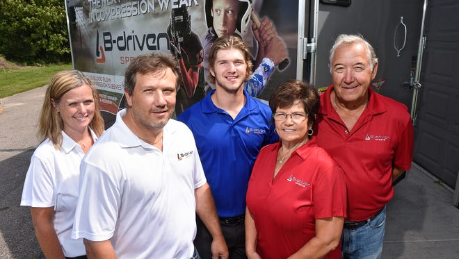 Schmitz family members stand Tuesday next to a trailer with the logo of B-Driven Sports  near Sauk Rapids. Pictured, from left to right, are Paula, Jim, Bo, Kathey and Ralph Schmitz.